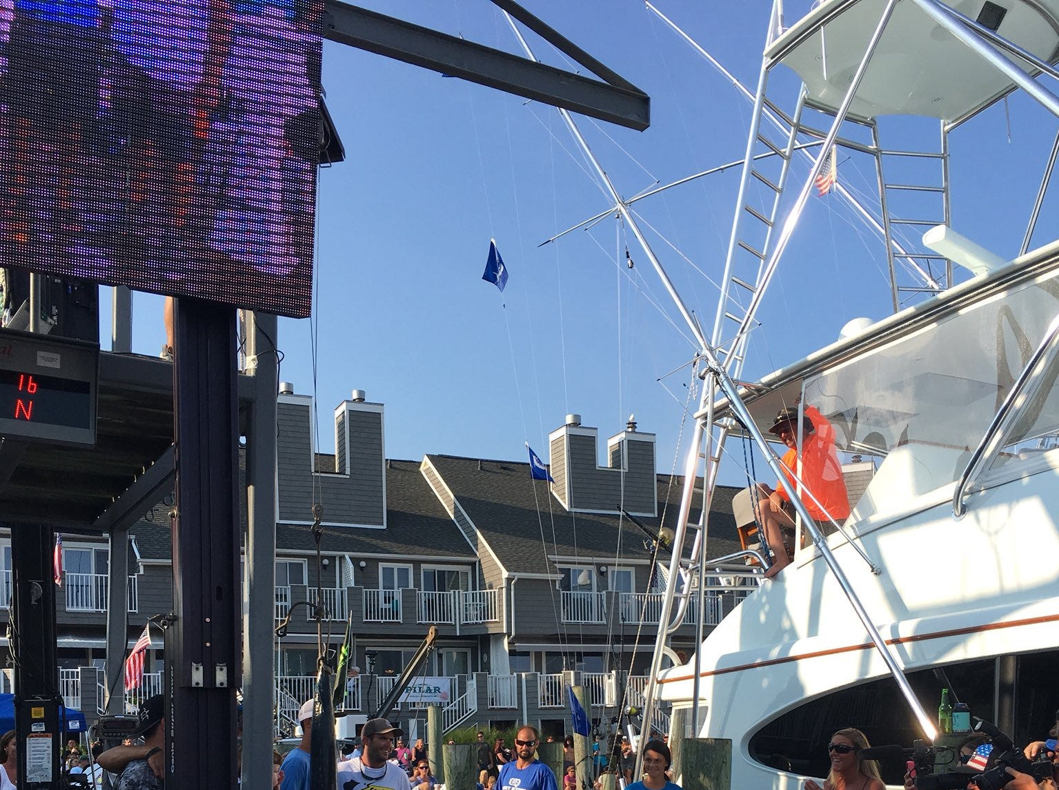 Angler Bill Haugland with his boat, Lights Out, caught the first qualifying white marlin in the at 75 pounds during day 2 of the White Marlin Open fishing tournament in Ocean City, Maryland on Aug. 7, 2018.