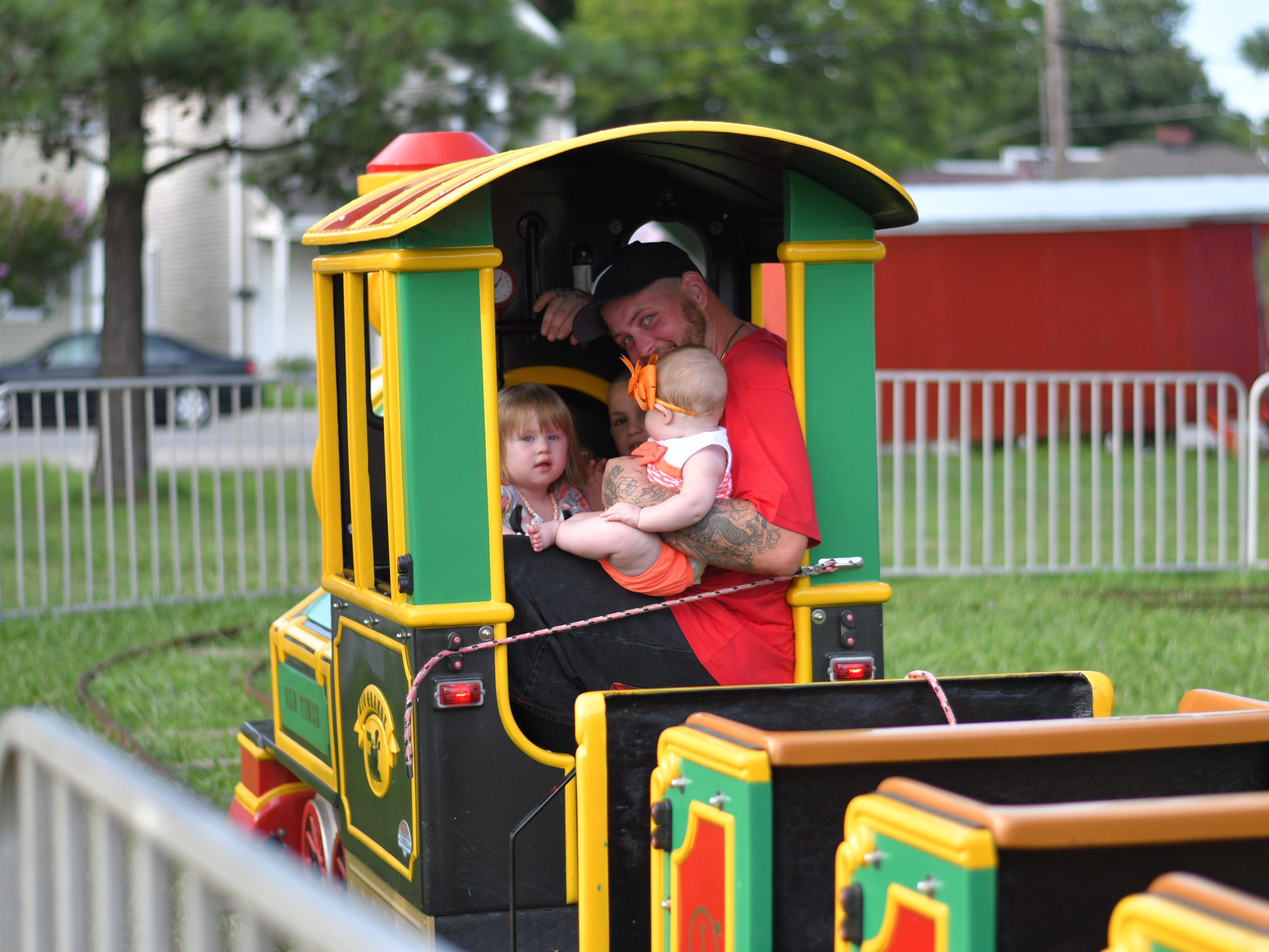Eltor Merritt enjoys a carnival ride with his children during the Cape Charles carnival on  Aug. 5.