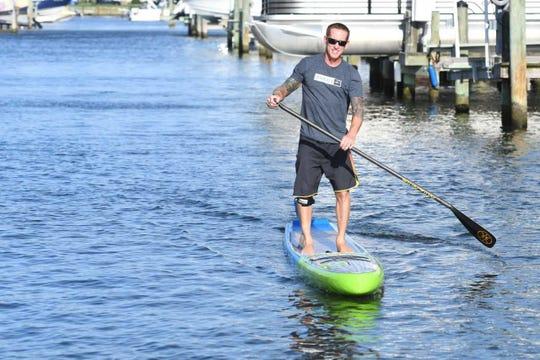 Wayne Best smiles as he paddles through the water in Ocean City.