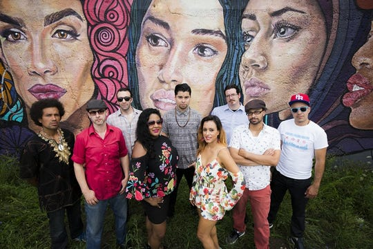 Opening act ¡ESSO! Afrojam Funkbeat performs at the free Levitt AMP Sheboygan Music Series concert, Thursday, Aug. 9, at the City Green.