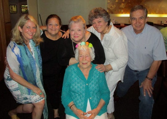 Birthday Girl Betty McJunkins (seated) poses with her family at her 90th Birthday Celebration at Cantina Laredo: Meg Barkley (far left), Beth Falls, Jan Cook, Patty Miller, Russell McJunkins.