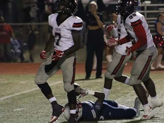 Many's Myron Warren (99) is involved in a tackle against North DeSoto.