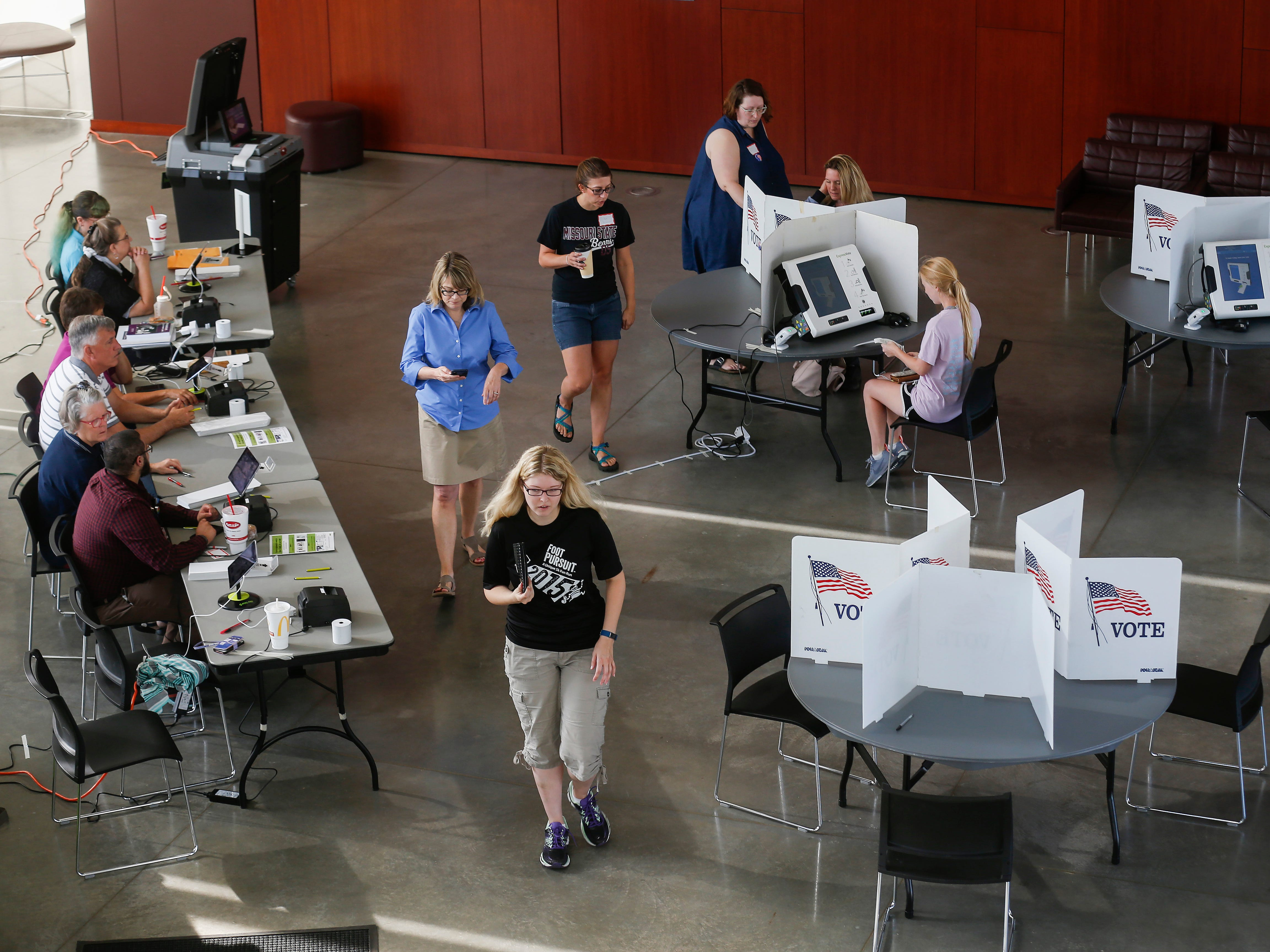 Voters cast their ballots at the Davis-Harrington Welcome Center at Missouri State University on Tuesday, Aug. 7, 2018.