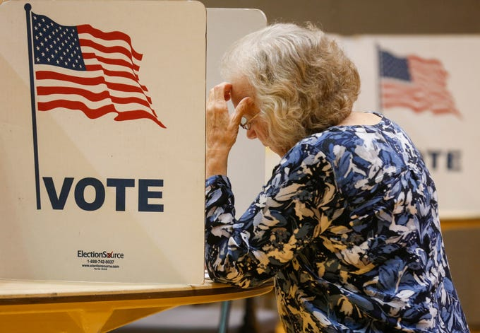 Maureen Youngman fills out her ballot at the Second Baptist Church on Tuesday, Aug. 7, 2018.