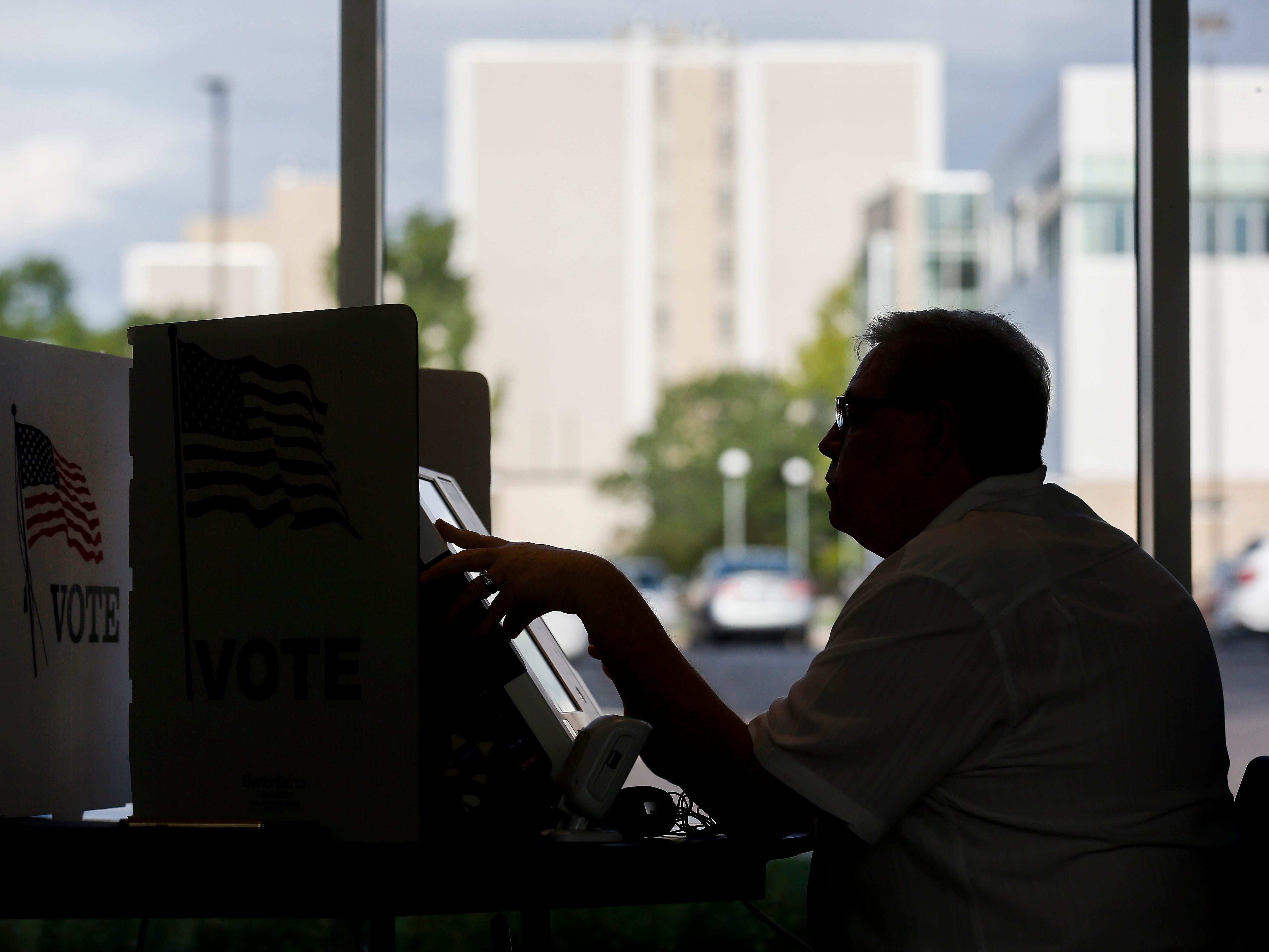 Gary Stewart uses the Express Vote machine to cast his ballot at the Davis-Harrington Welcome Center at Missouri State University on Tuesday, Aug. 7, 2018.