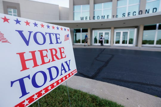 Voters walk into the Second Baptist Church to cast their ballots on Tuesday, Aug. 7, 2018.