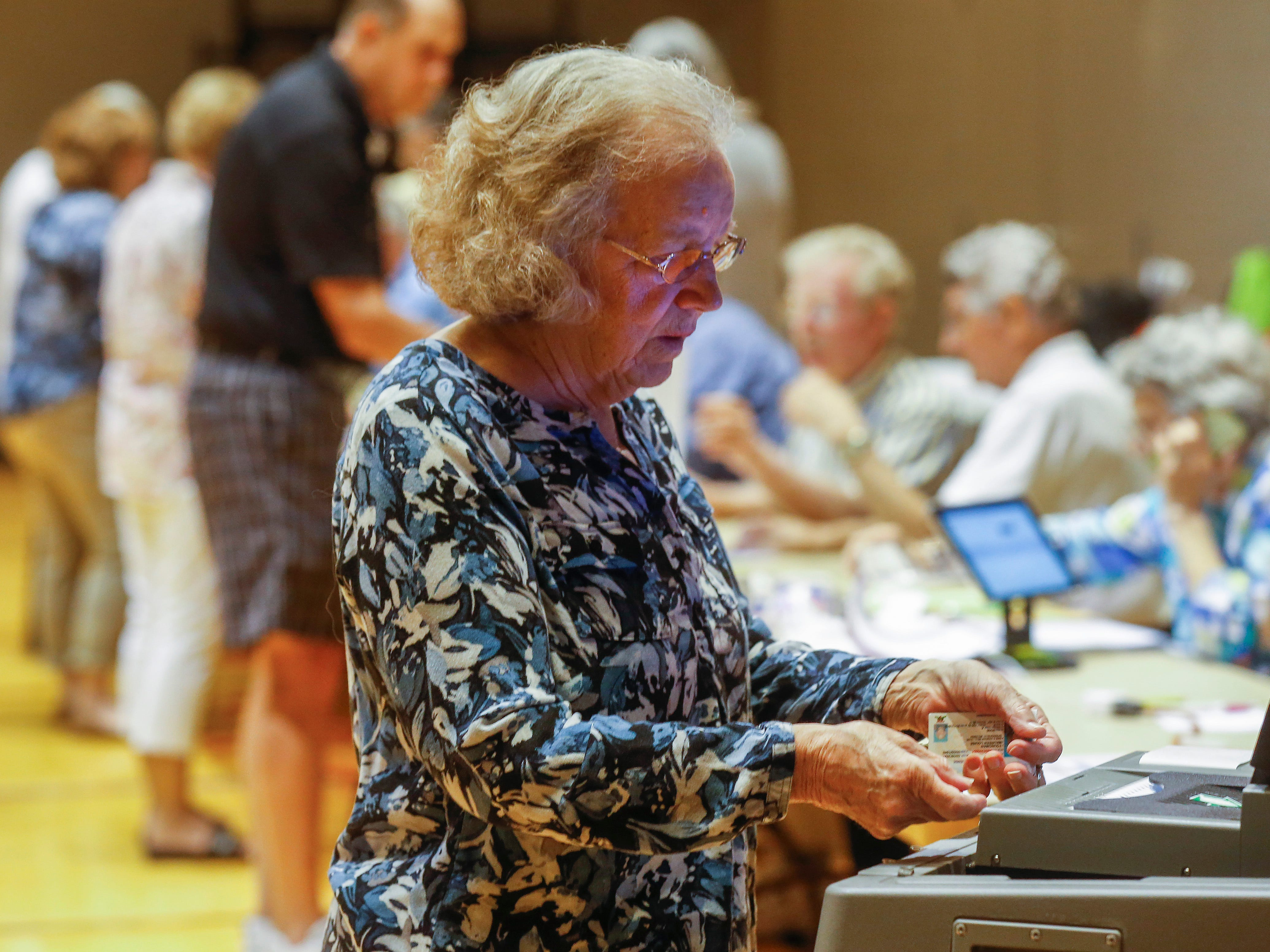 Maureen Youngman casts her ballot at the Second Baptist Church on Tuesday, Aug. 7, 2018.
