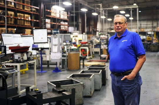 Norman Smith stands on the manufacturing floor in Nibco on Thursday, Oct. 10, 2013, in Stuarts Draft. Smith will celebrate 50 years at the company on October 14.