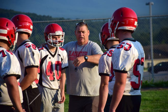 Robert Casto, Riverheads' head football coach, coaches his players through an offensive exercise during their first practice of the season on Monday, Aug. 6, 2018, at Riverheads High School in Greenville, Va.
