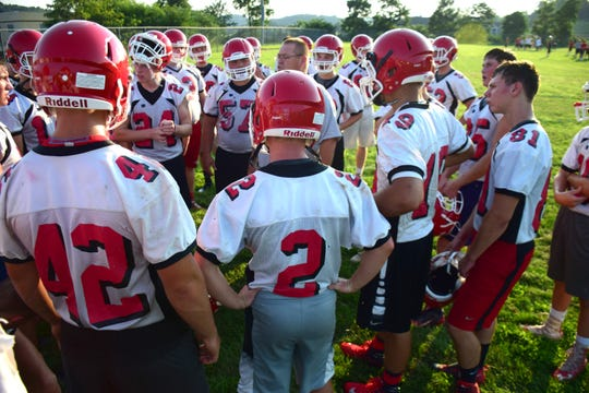 Robert Casto, Riverheads' head football coach, talks to his players during a break in their first practice of the season on Monday, Aug. 6, 2018, at Riverheads High School in Greenville, Va.