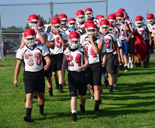 Riverheads players march on to the field for their first practice of the high school football season on Monday, Aug. 6, 2018, at Riverheads High School in Greenville, Va.