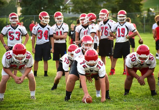 A Riverheads quarterback calls signals for a play during the Gladiators' first practice of the season on Monday, Aug. 6, 2018, at Riverheads High School in Greenville, Va.