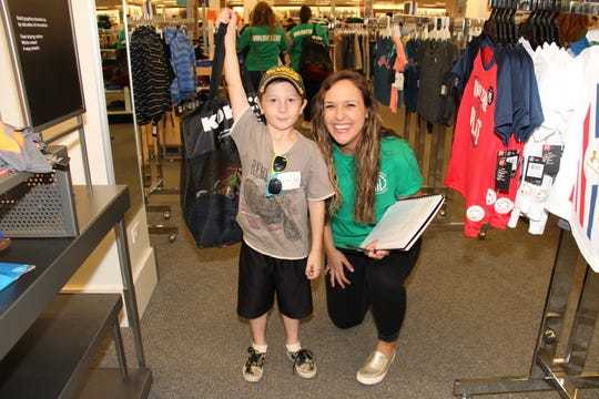 Volunteers accompanied students and their families to help make their shopping experience fun and memorable.