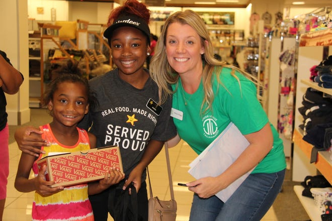 Members of the Junior League of Tallahassee helped 80 local children shop for back-to-school items at its annual Kids' Boutique shopping event on Sunday.