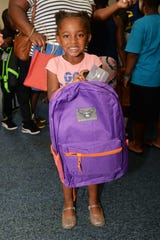 Myliyah Miller is ready for school with her new backpack full of supplies at First Baptist Church of Fort Pierce and River of Life Fellowship's joint Back 2 School Bash.