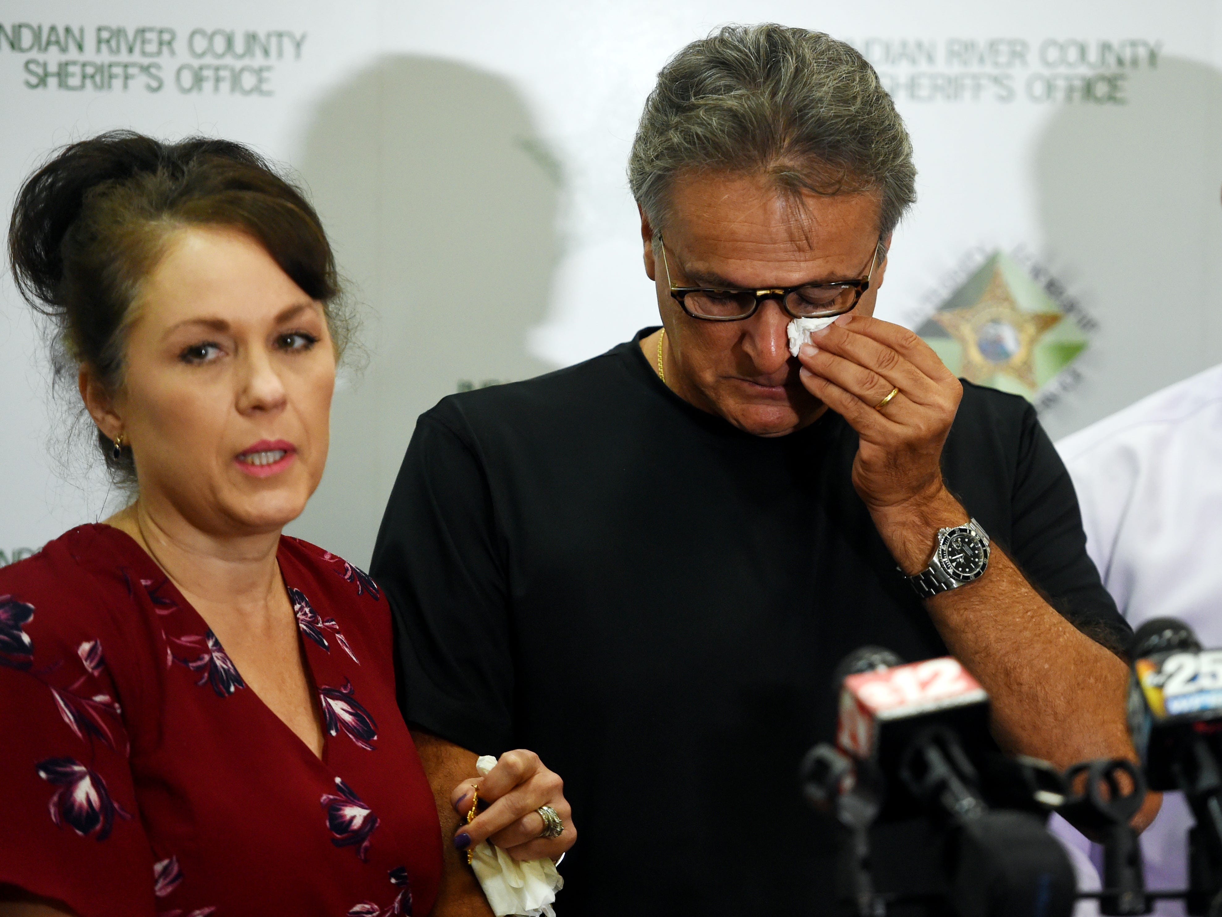 "An emotional Patrick Tomassi wipes tears away from his eyes as he and daughter-in-law Cary Baker make another plea to the public for information concerning the disappearance of Susy Tomassi, 73, during a press conference at the Indian River County Sheriff's Office on Tuesday, Aug. 7, 2018. Susy Tomassi, who has dementia, walked away from the family restaurant, Quilted Giraffe, and was last seen on security cameras in South Vero Square shopping plaza. ""The case is active, it's not in any way cold, it's being investigated daily,"" said Detective Mike Dilks, the lead on the investigation. ""This is in no way a cold case, this is not a case on the back burner. This case is front and center of my career."" The family is offering a $15,000 reward for her safe return."