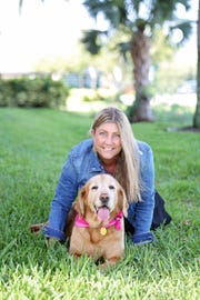 The Farm Dog Rescue's founder Keri Burgess cuddles Bella.