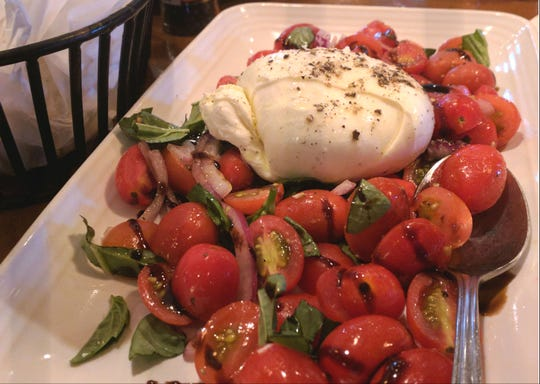 Carrabba's burrata mozzarella was surrounded by lots of tiny, sweet grape tomatoes, fragrant basil and red onion dressed in olive oil and a tangy balsamic glaze.
