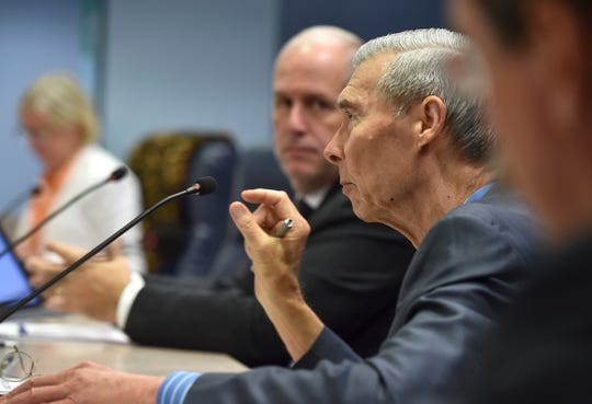 Martin County Commissioner Ed Fielding (center right) confers with commissioners (from left) Sarah Heard, Edward Ciampi, and Doug Smith (far right) before a unanimously passing a motion made by commissioner Sarah Heard during the Martin County Board of County Commissioners emergency meeting about the algae and water conditions, on Tuesday, August 7, 2018, at the commission chamber in Stuart. Commissioner Harold Jenkins was not in attendance.