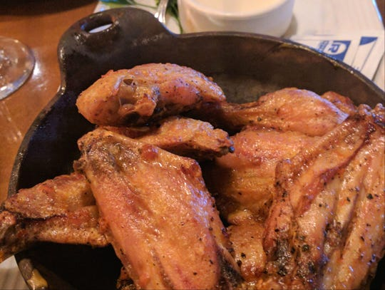 Carrabba's roasted chicken wings lightly seasoned with Italian chili pepper and served with Gorgonzola dipping sauce.