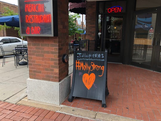 A #MollyStrong sign sits outside of Jalapenos Restaurant in downtown Wausau during a fundraiser on Aug. 7. 2018.