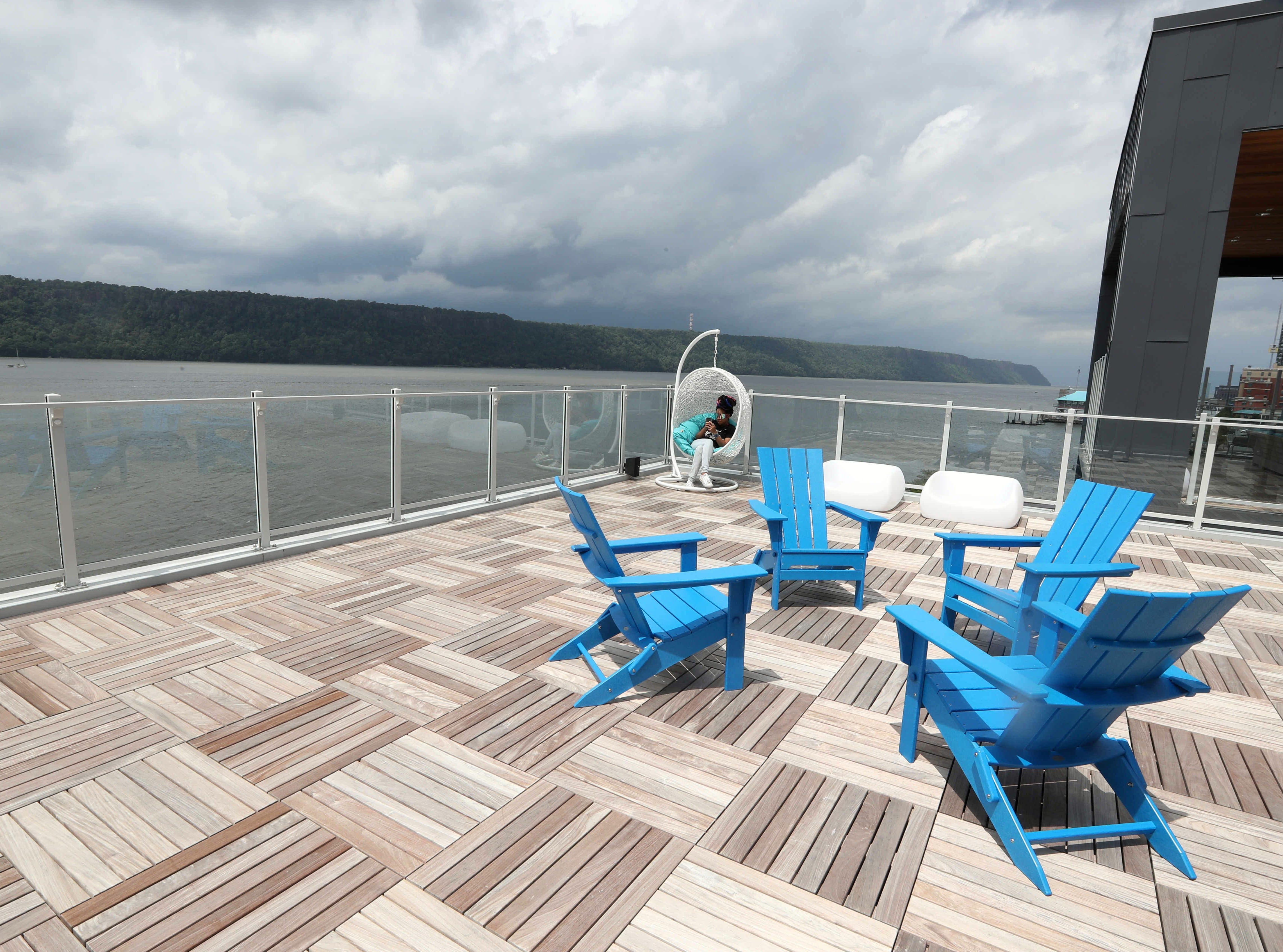 Crystal Barnes spends time on the deck of the sky lounge at the Modera, a new luxury apartment building on the Yonkers riverfront Aug. 1, 2018. The Modera, which opened in January, will have over three-hundred studio, one-bedroom, and two-bedroom apartments when all when the building is totally completed.