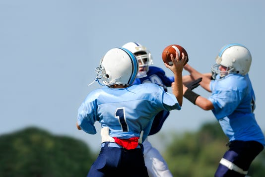 Young Quarter Back Throwing A Pass