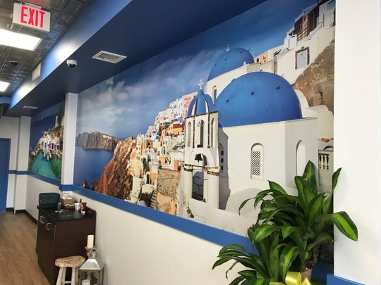 Murals of Greece line the walls at Dimitris Gryo Grill in Harrison.