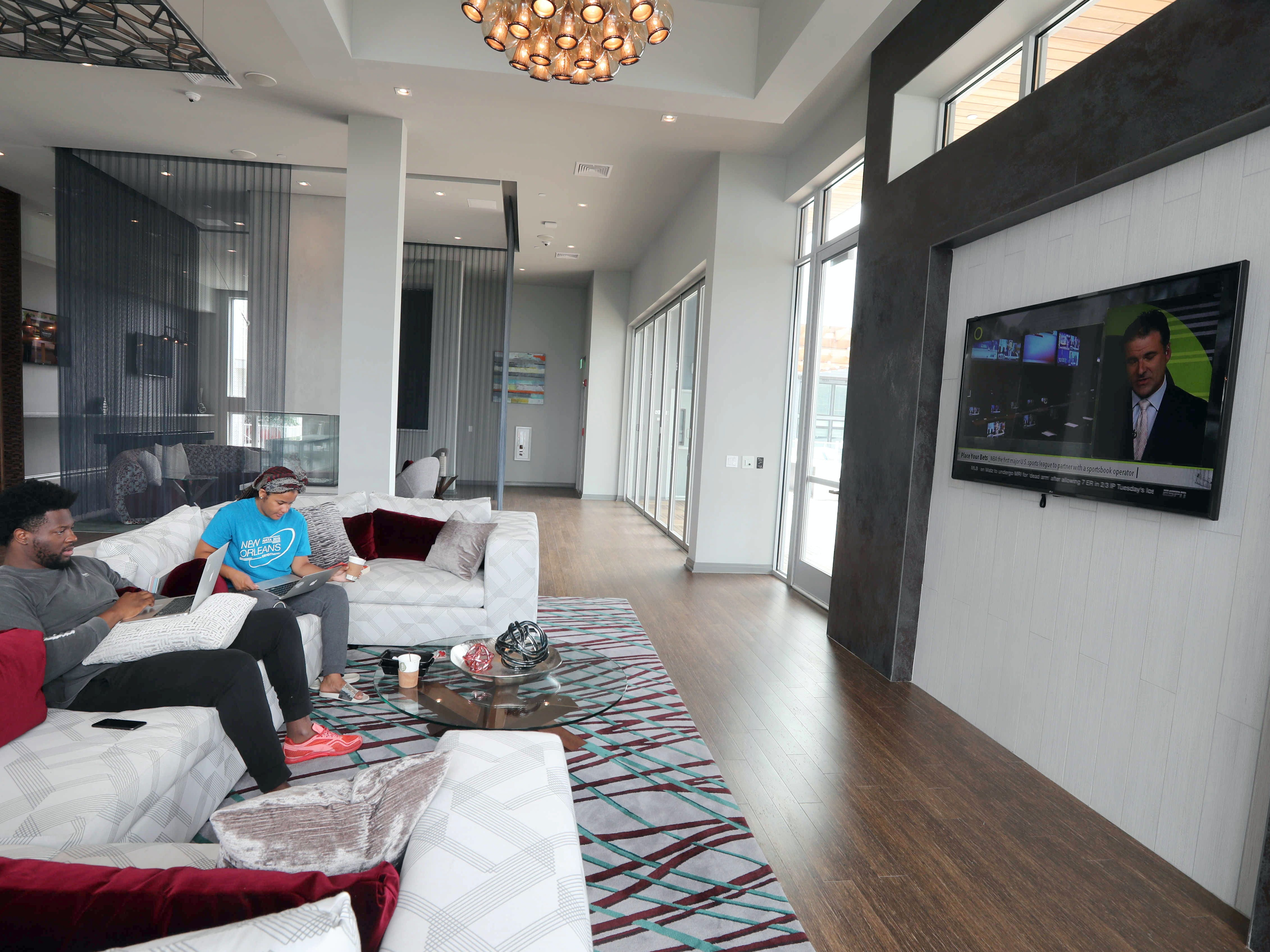 Ike Echebiri and Carolyn Smith spend time in the sky lounge at the Modera, a new luxury apartment building on the Yonkers riverfront Aug. 1, 2018. The Modera, which opened in January, will have over three-hundred studio, one-bedroom, and two-bedroom apartments when all when the building is totally completed.