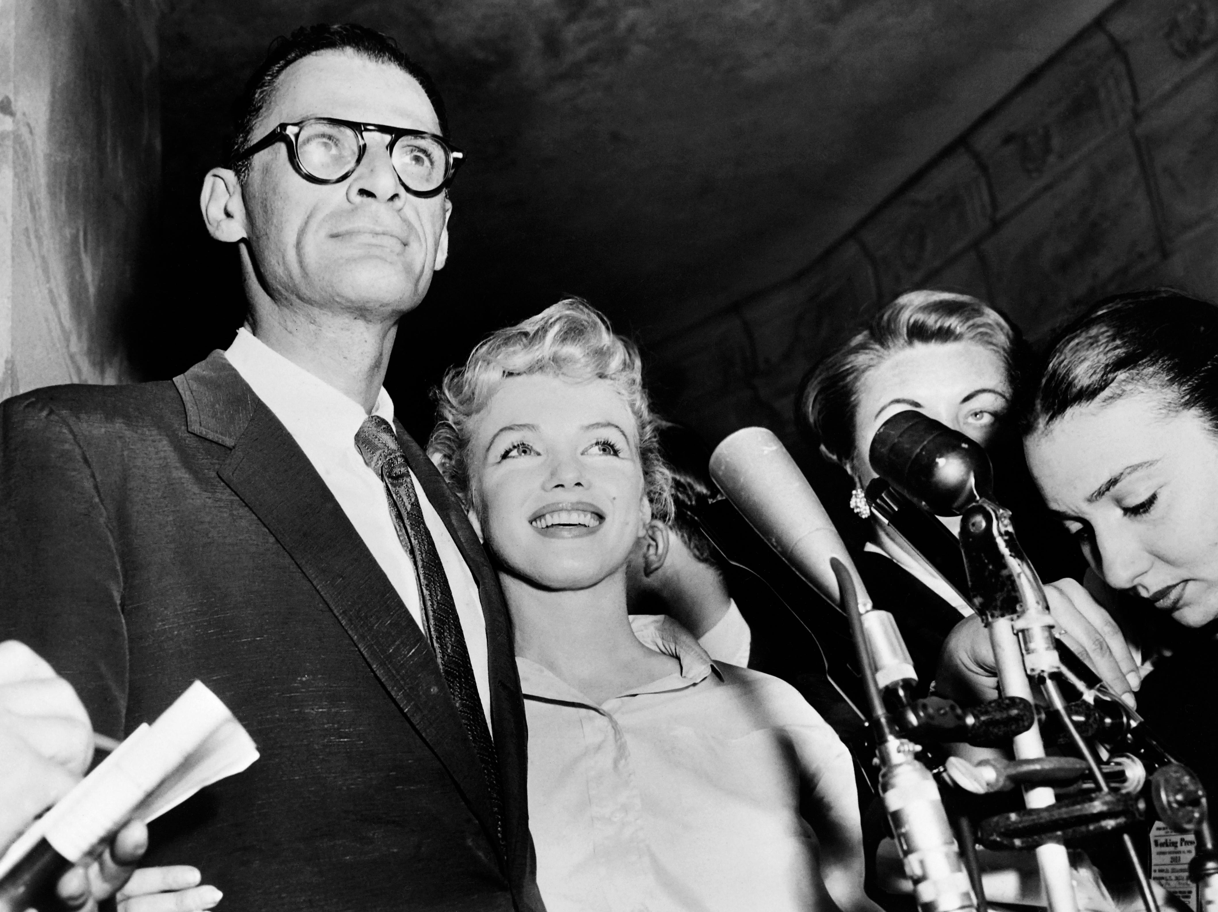 A undated picture shows US actress Marilyn Monroe (C) and her husband US playwright Arthur Miller (L). Monroe's unpublished writings will be published in France and in around ten countries next October, according to French publishing house Le Seuil on August 5, 2010. AFP PHOTO (Photo credit should read /AFP/Getty Images)