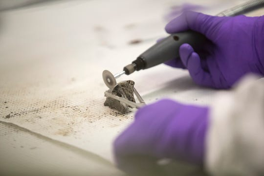 A Dremel tool is used on human remains in the early stages of potentially identifying a U.S. serviceman by a forensic scientist at the Department of Defense DNA Operations for the Armed Forces Medical Examiner System at Dover Air Force Base.