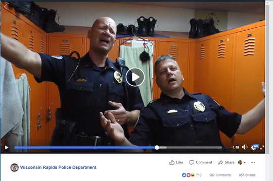 "Lt. Brian Krzykowski and Lt. Joel Flewellen of the Wisconsin Rapids Police Department perform ""Hakuna Matata"" from ""The Lion King"" in a clip from the department's lip sync challenge video."