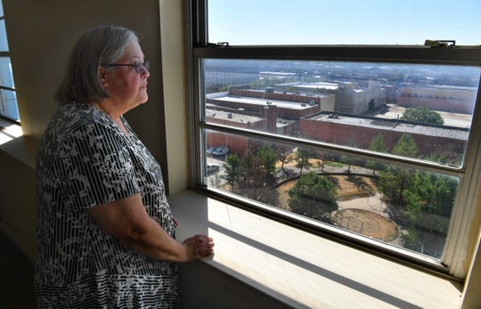 In this 2018 file photo, Mona Statser, then-executive director of Workforce Solutions North Texas looks out the window of an office on the eighth floor of Big Blue. Statser and the organization expected to move all their offices to Big Blue, but two years later, the former tenant is being sued by Big Blue for breach of contract. Statser retired from the organization in May 2019, and said she has little knowledge of the situation.