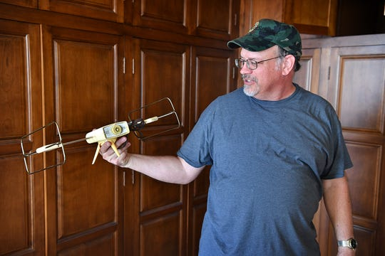 Maintenance technician James Cunningham displays a 1960s television antenna found in a cabinet of an office being renovated in Big Blue downtown. Workforce Solutions North Texas will move their offices in later this month.
