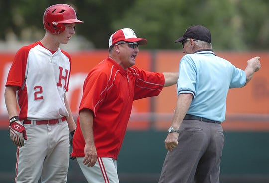 Holliday Eagles head coach Terry Wolf argues a questionable call with second base umpire Tom Benham as Colton Englishbee (2) looks on. Benham gave the Danbury Panthers a double play saying Englishbee interfered with the throw to first.