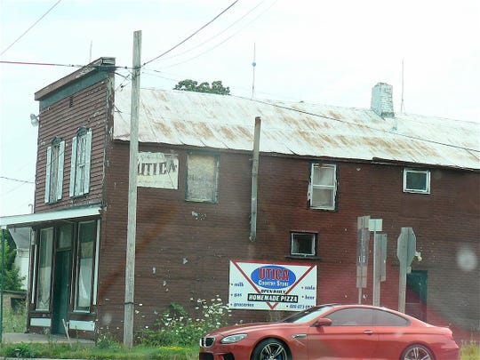 The once popular - for well over 100 years the Utica General Store - stands at the crossroads forlorn, empty and much missed by the community.