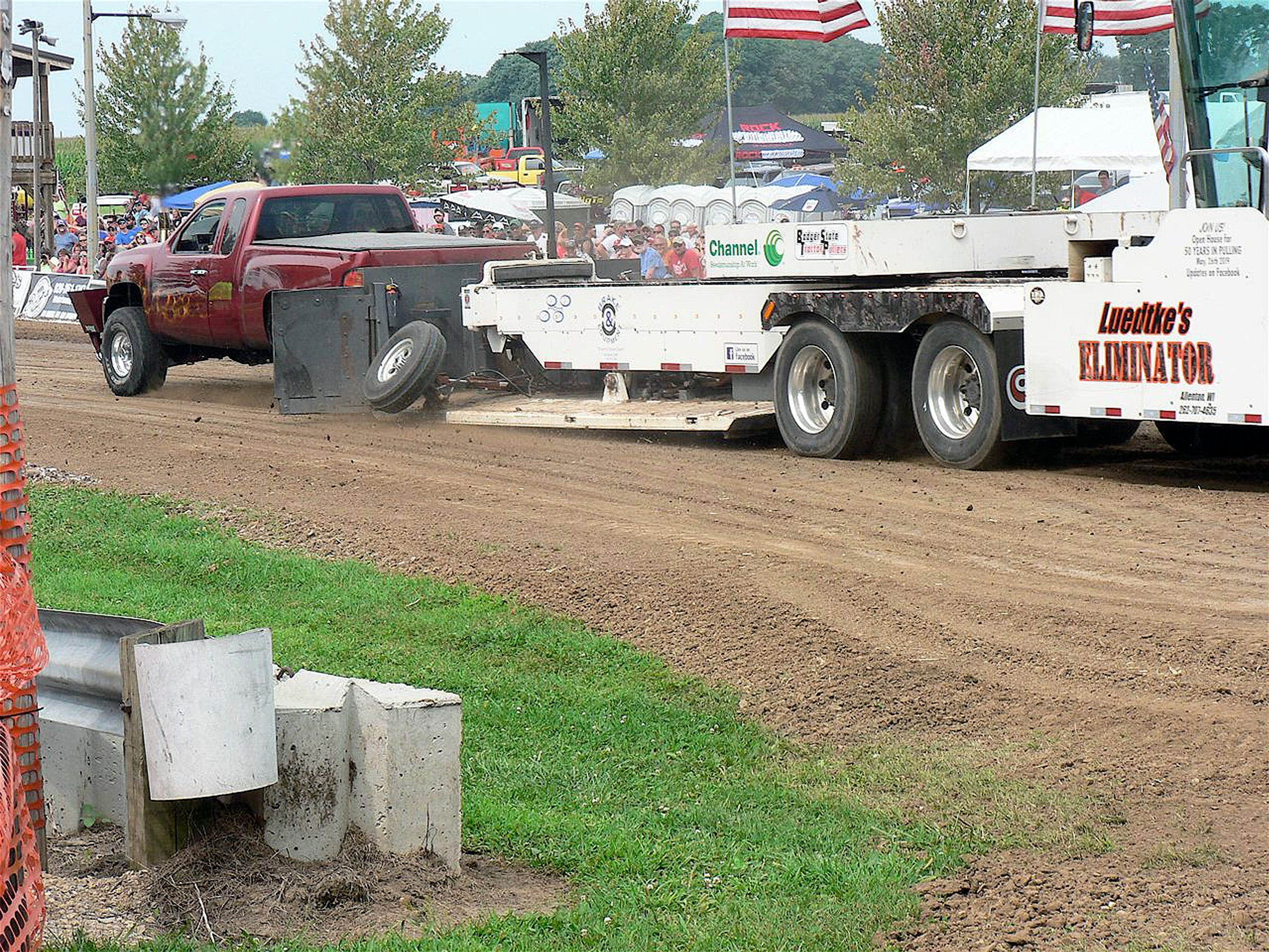 An ear-deafening roar is part of what the truck pull is about.