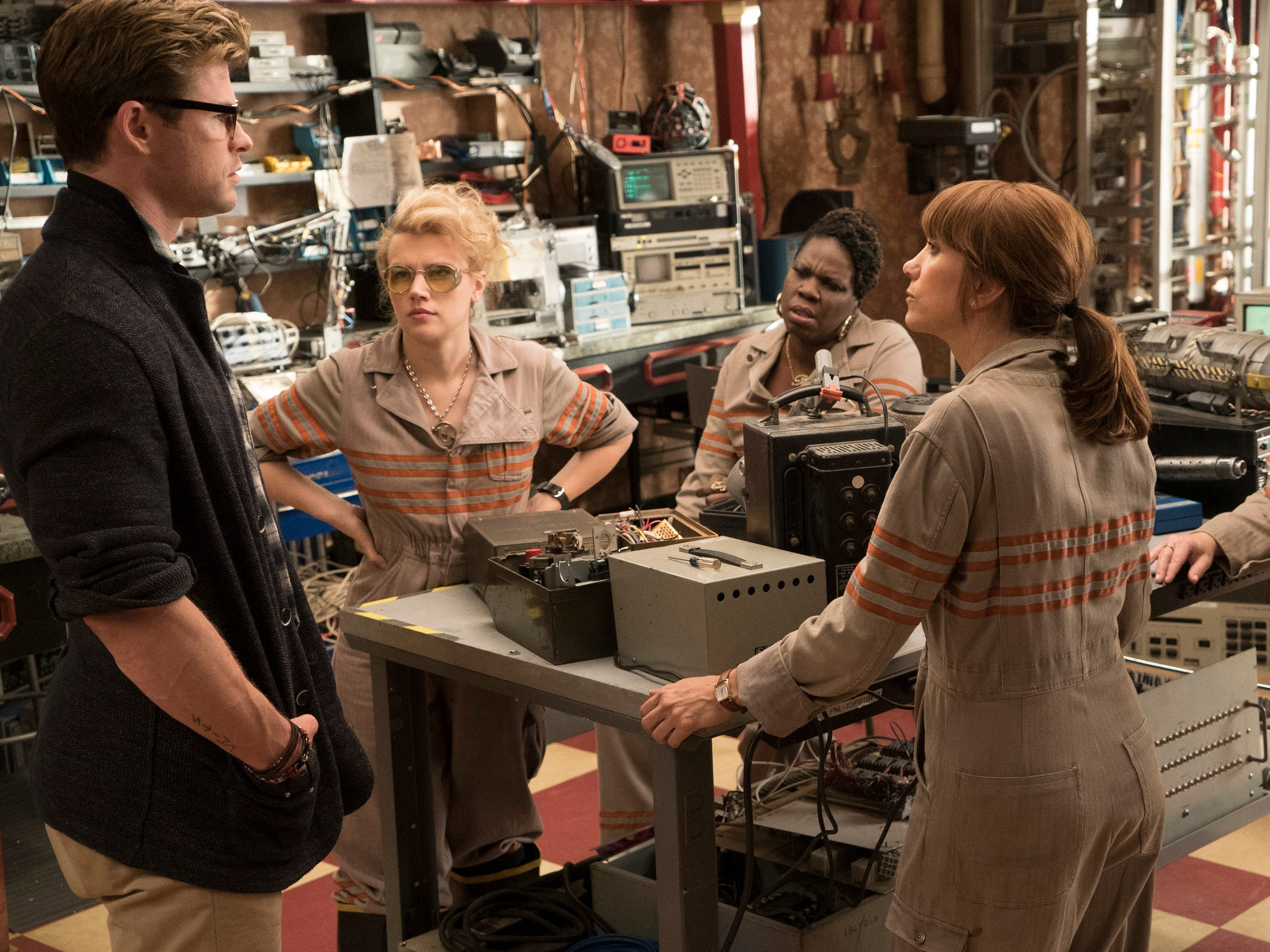 "Kevin (Chris Hemsworth is the receptionist for the paranormal-investigating crew of Holtzmann (Kate McKinnon), Patty (Leslie Jones), Erin (Kristen Wiig) and Abby (Melissa McCarthy) in ""Ghostbusters."""