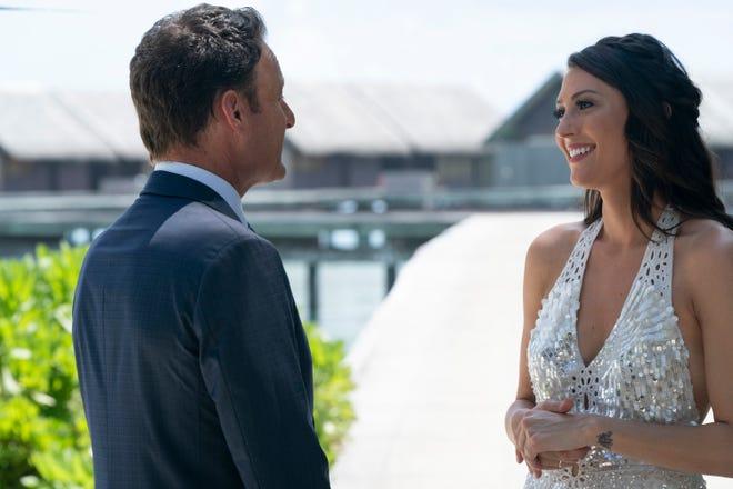 """Bachelorette"" Becca Kufrin, with the show's host Chris Harrison, chose Garrett Yrigoyen on the finale."