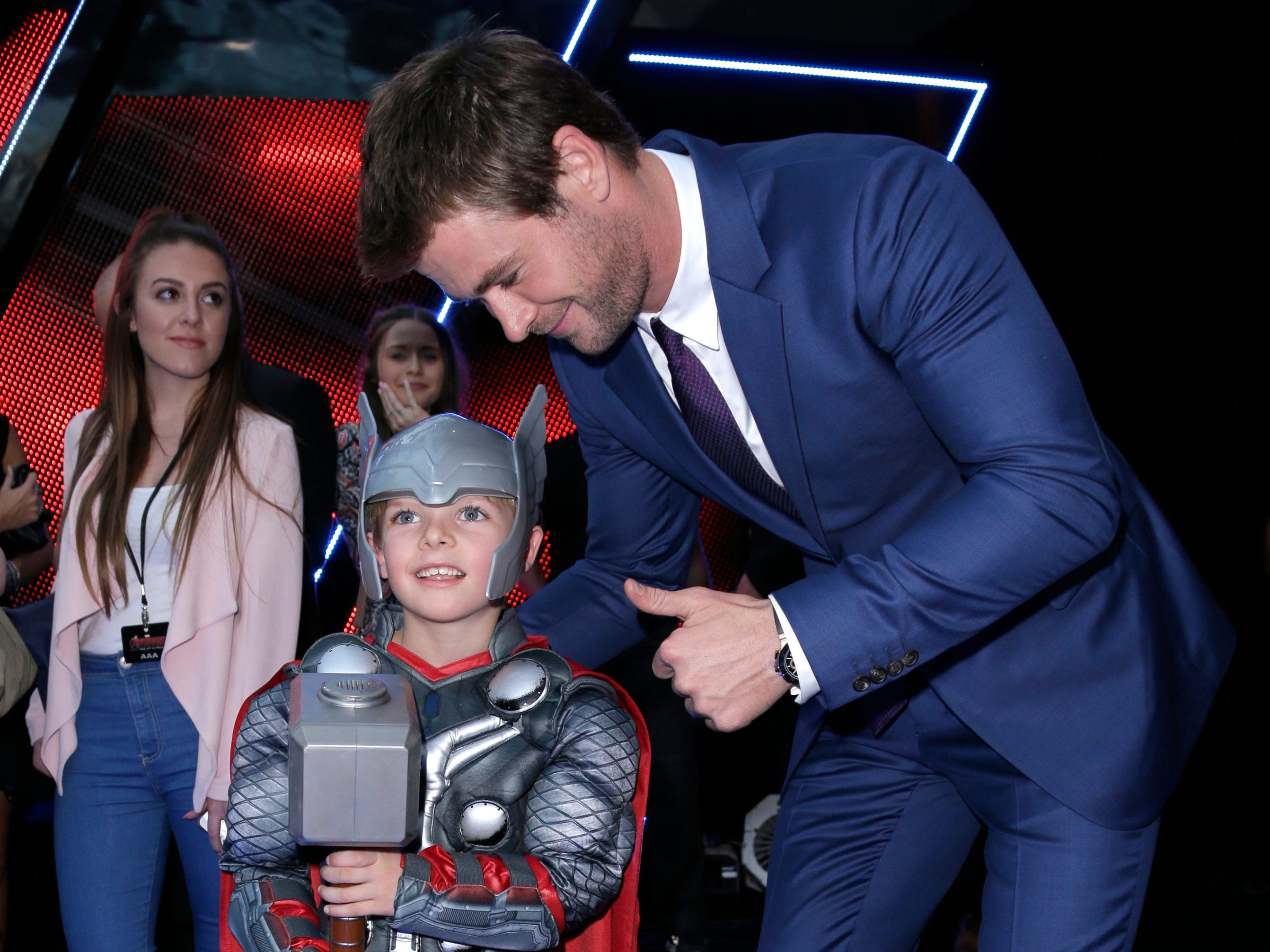 Chris Hemsworth poses with a young child dressed as the character Thor at the premiere for the film 'The Avengers Age of Ultron' in London, Tuesday, 21 April, 2015. (Photo by Joel Ryan/Invision/AP) ORG XMIT: LENT119
