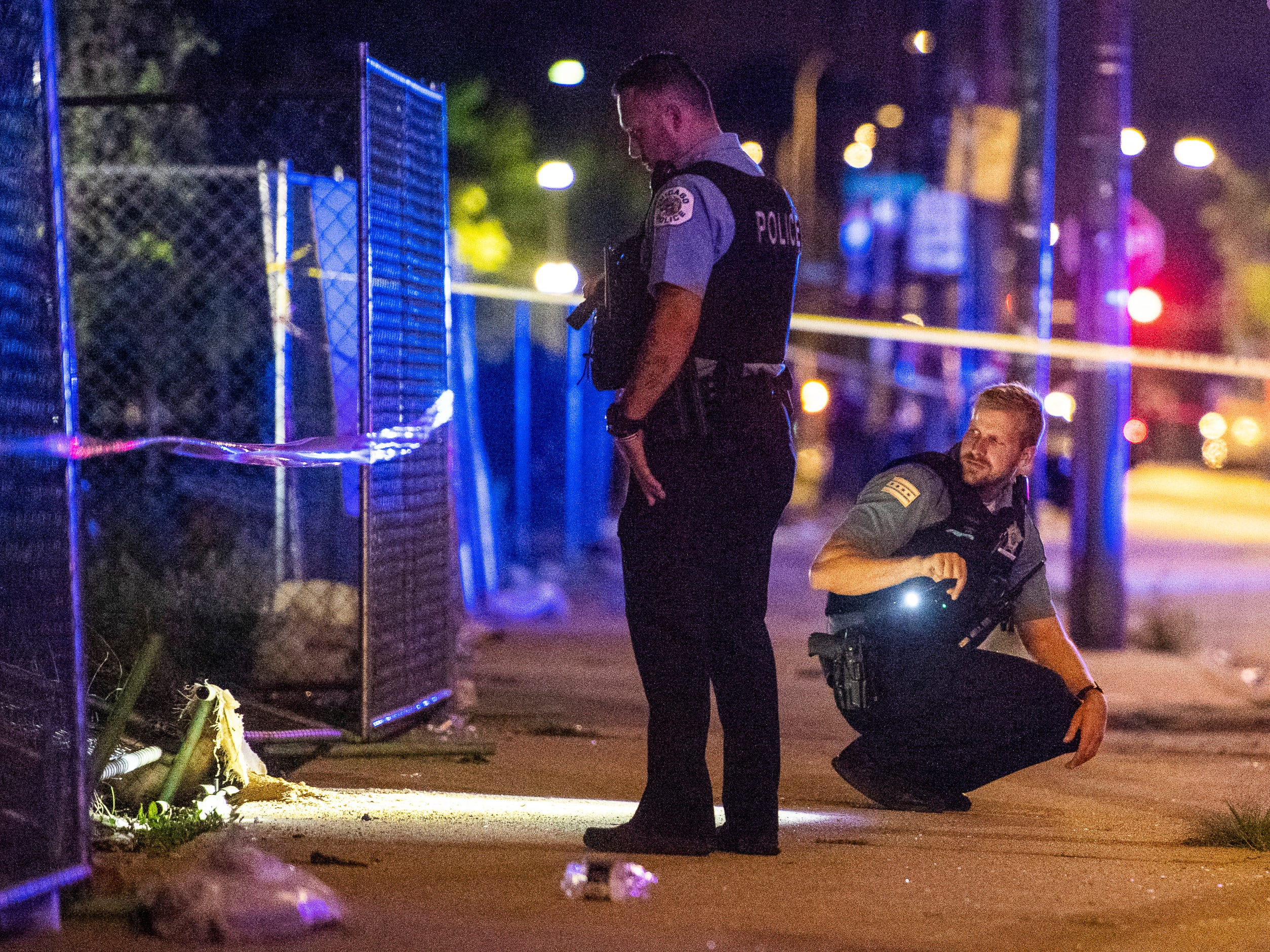 In this Aug. 5, 2018 photo, police investigate the scene where multiple people were shot in Chicago. Police Superintendent Eddie Johnson plans to discuss the violence during a Monday news conference.