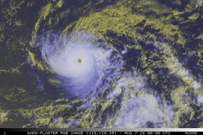 This satellite image provided by the National Oceanic and Atmospheric Administration shows a view of Hurricane Hector, Tuesday, Aug. 7, 2018. A tropical storm watch was in effect for the Big Island as Hector was expected to pass Tuesday night and Wednesday as it moved westward.