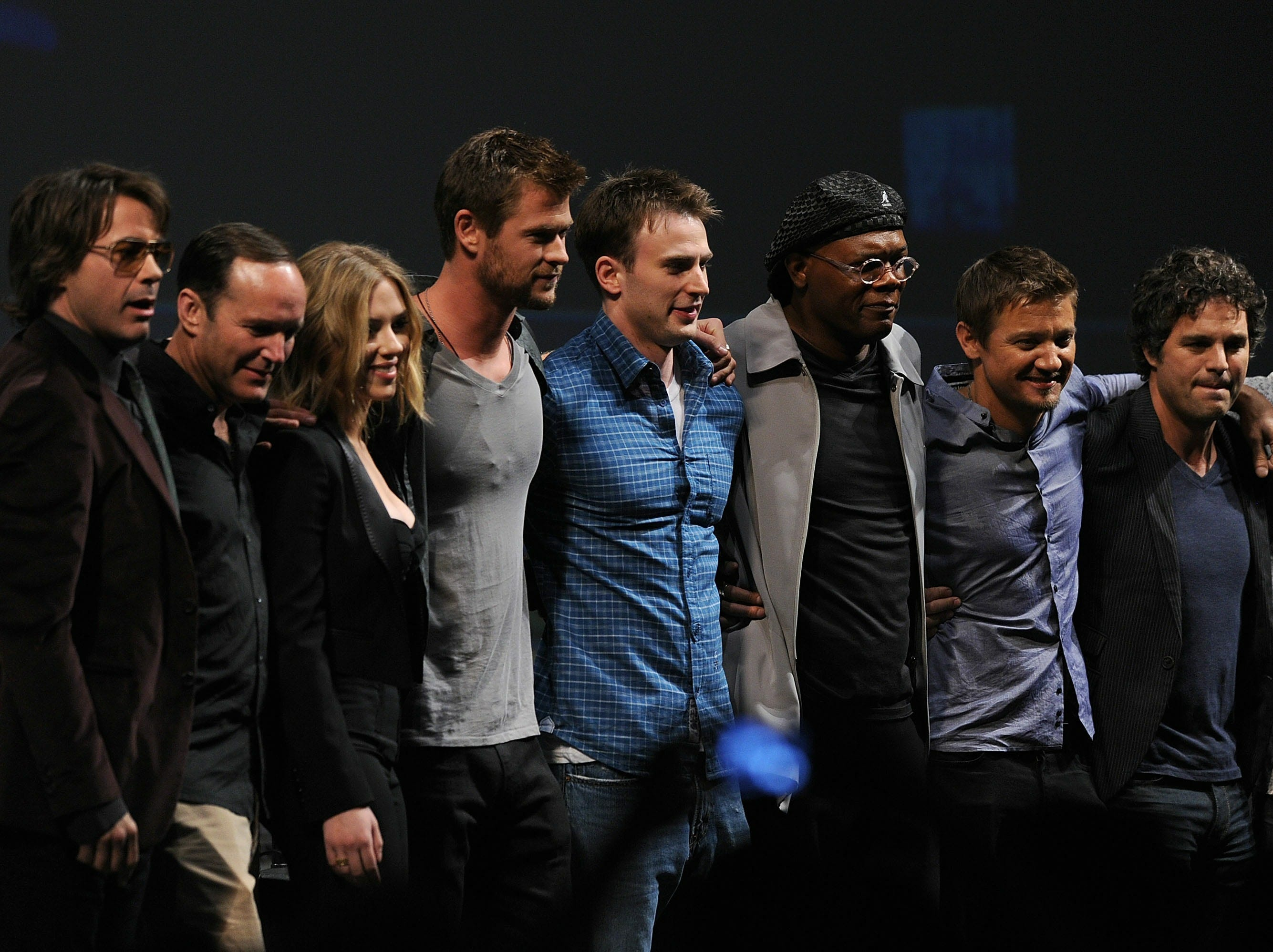 "ORG XMIT: 102640660 SAN DIEGO - JULY 24:  (L-R) Actors Robert Downey Jr., Clark Gregg, Scarlett Johansson, Chris Hemsworth, Chris Evans, Samuel L. Jackson, Jeremy Renner, Mark Ruffalo and writer/Director Joss Whedon pose onstage at the Marvel Studios' ""Captain America: The First Avenger"" panel during Comic-Con 2010 at San Diego Convention Center on July 24, 2010 in San Diego, California.  (Photo by Kevin Winter/Getty Images) GTY ID: 640660TT005_Marvel_Studi"