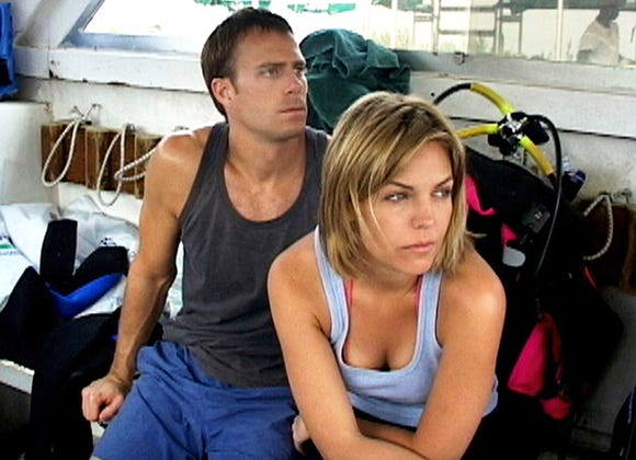 "Daniel Travis and Blanchard Ryan star as the victimized scuba-diving couple of ""Open Water."""