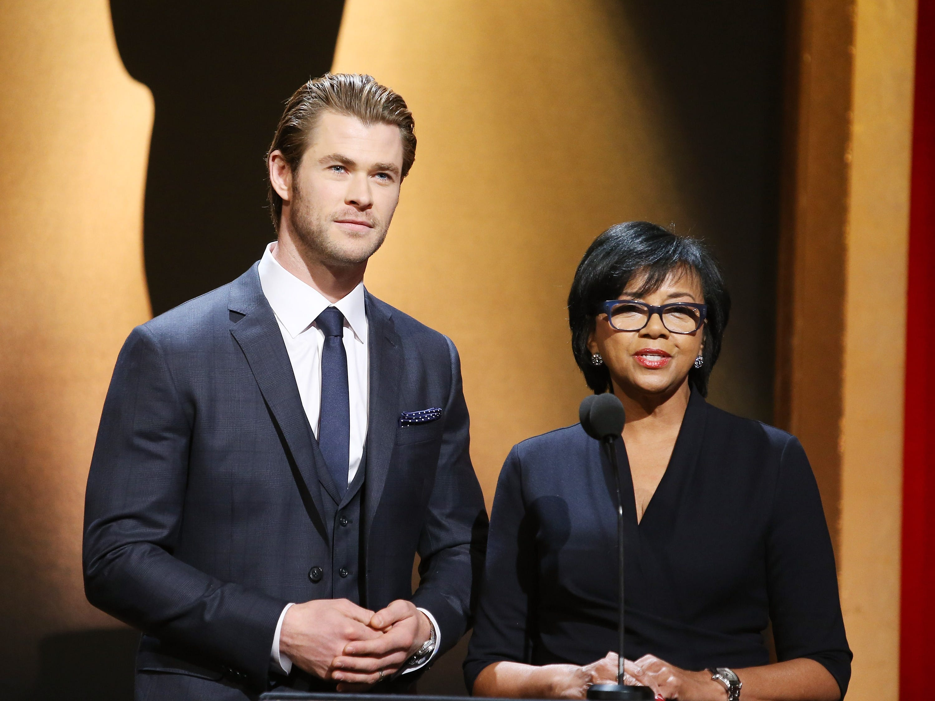 BEVERLY HILLS, CA - JANUARY 16:  Chris Hemsworth and Academy President Cheryl Boone Isaacs announce the nominees at the 86th Academy Awards nominations announcement held at AMPAS Samuel Goldwyn Theater on January 16, 2014 in Beverly Hills, California.  (Photo by Michael Tran/FilmMagic) ORG XMIT: 463283781 ORIG FILE ID: 462955629