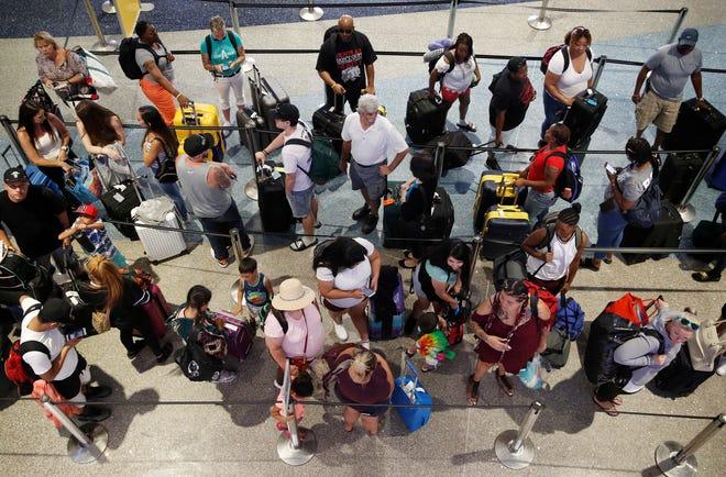 Travelers wait in line June 29, 2018, to check in at McCarran International Airport in Las Vegas.