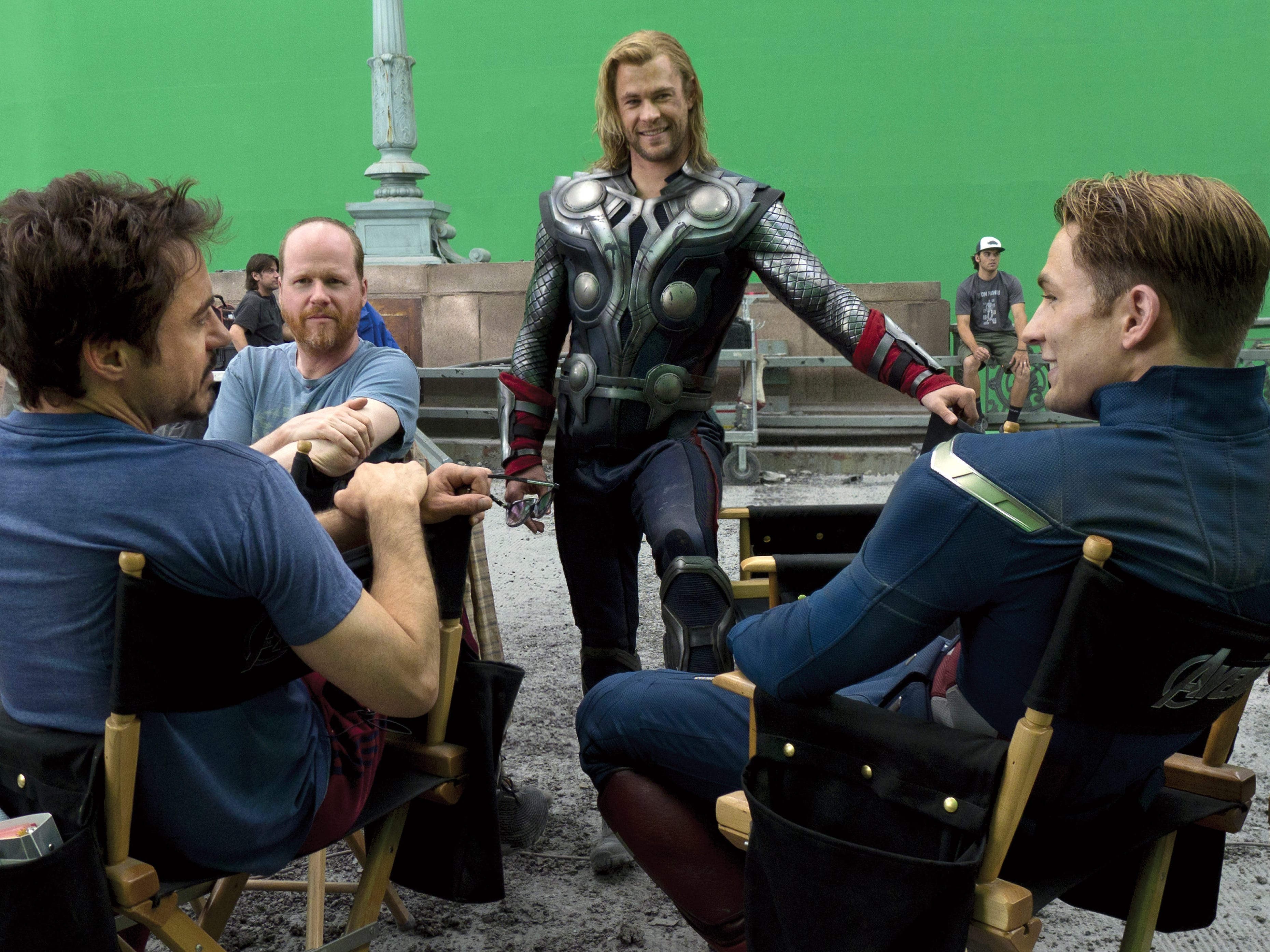 "ROBERT DOWNEY JR., left, JOSS WHEDON, CHRIS HEMSWORTH, and CHRIS EVANS on the set of the motion picture ""Marvel's The Avengers.""  Photo by Zade Rosenthal, Marvel [Via MerlinFTP Drop]"
