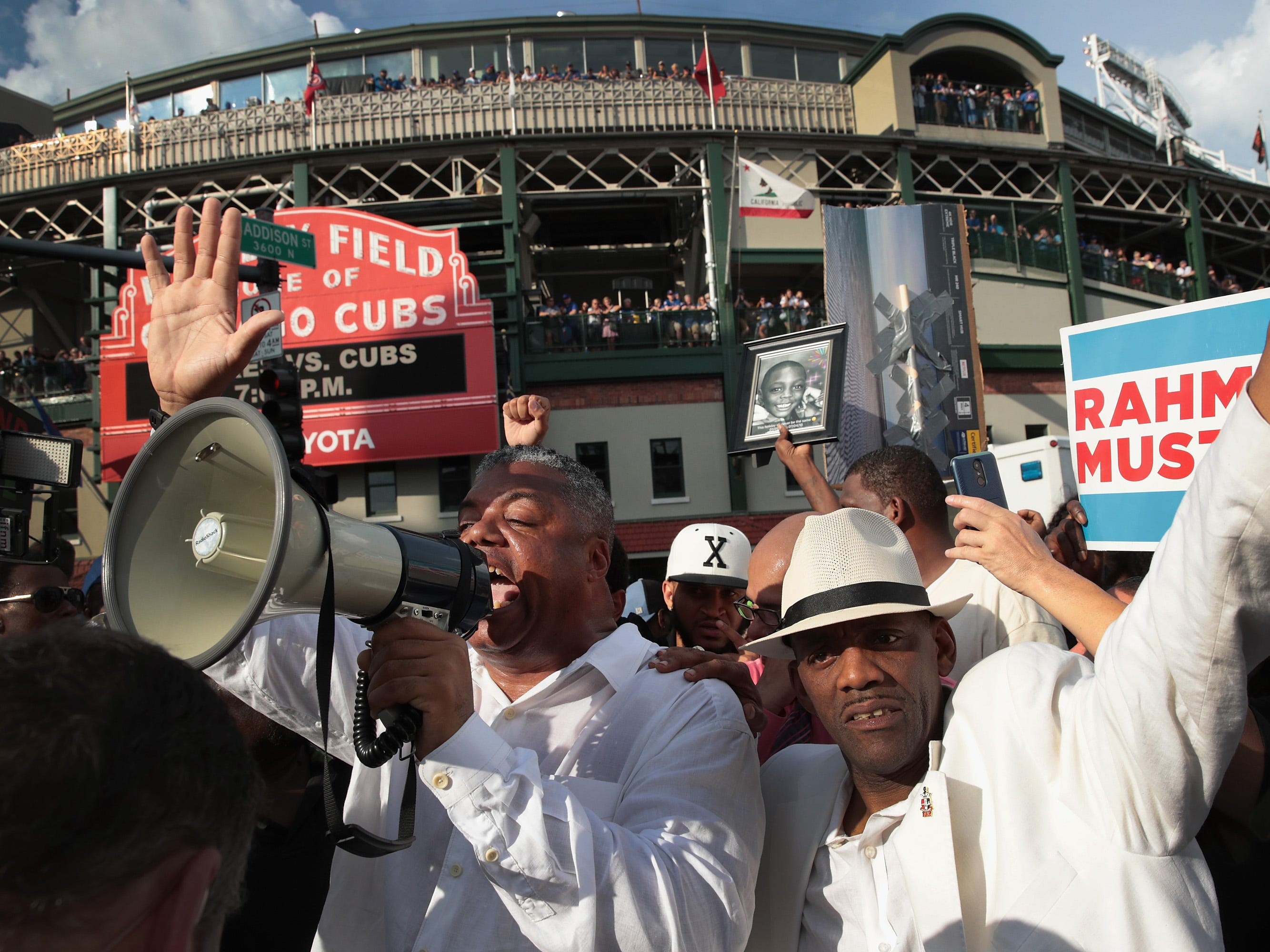 Demonstrators protest in front of Wrigley Field before  the start of the matchup between the Cubs and the Padres on Aug. 2, 2018 in Chicago, IL. The demonstrators, who marched from Lake Shore Drive and through the nearby neighborhoods were protesting the ongoing violence, corruption and the lack of economic investments in African-American communities on the city's west and south sides.
