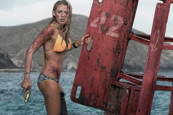 "Blake Lively fends off a hungry shark with smarts and a flare gun in ""The Shallows."""