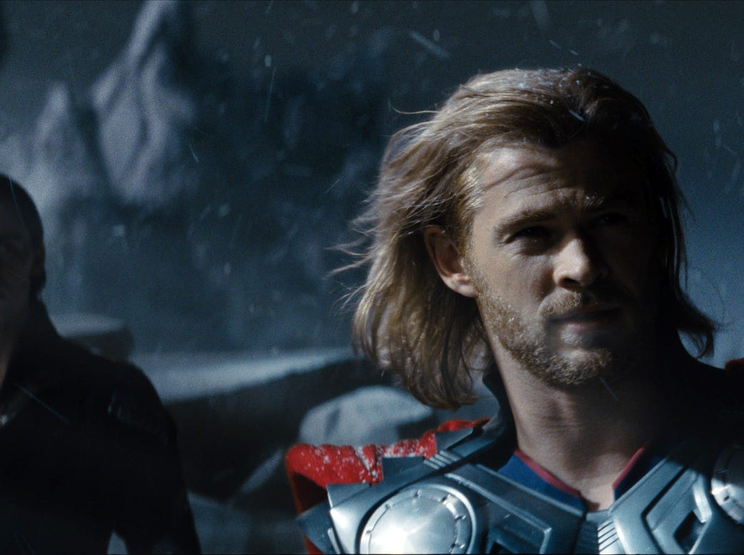 "Loki (Tom Hiddleston, left,) and Thor (Chris Hemsworth) in a scene from the motion picture ""Thor."" Photo by Paramount Pictures / Marvel Studios [Via MerlinFTP Drop]"